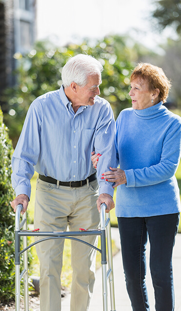 image of elderly couple walking.